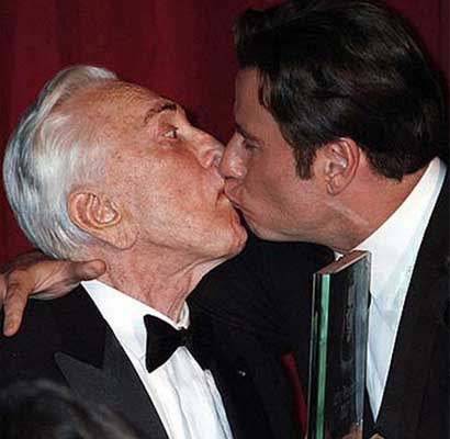John Travolta kisses Kirk Douglas